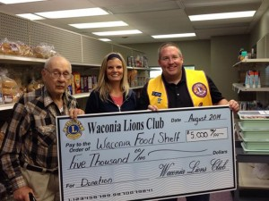 Pictured here Joe Koppi, Waconia Food Shelf volunteer, Marit Rinke, Food Shelf coordinator, Shawn Sweeney, Lions Club representative.